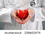 doctor or cardiologist holding... | Shutterstock . vector #258602474