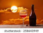 bottle and glass of red wine on ... | Shutterstock . vector #258643949