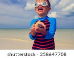 Little Boy Holding Seashells O...