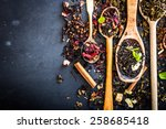 Stock photo virious kinds of tea in wooden spoons on black table 258685418