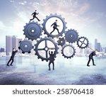 many businessman pushing gears  ... | Shutterstock . vector #258706418
