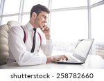 smiling  businessman is working ... | Shutterstock . vector #258782660