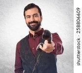 man wearing waistcoat talking... | Shutterstock . vector #258806609