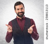 man wearing waistcoat pointing... | Shutterstock . vector #258813113
