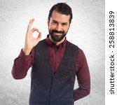 man wearing waistcoat making ok ... | Shutterstock . vector #258813839