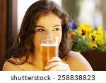 Portrait Of A Woman Drinking...
