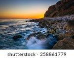 Waves Crashing On Rocks At...