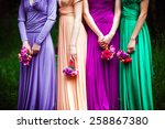 Bridesmaids In Colorful Dresse...