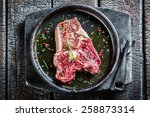 Closeup of beef with rosemary and pepper ready for grilling - stock photo