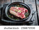 Red meat with herbs ready for grilling - stock photo