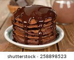 Chocolate Pancakes On A Brown...