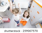 happy kid on a weighing... | Shutterstock . vector #259007570