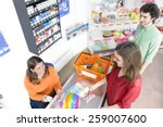 people in a market at checkout   Shutterstock . vector #259007600