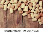 wine corks on wooden background | Shutterstock . vector #259014968