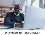 young businessman working on... | Shutterstock . vector #259040684