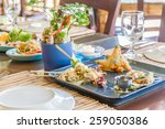 table setup in outdoor cafe ... | Shutterstock . vector #259050386