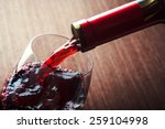 Closeup Red Wine Pouring Glass - Fine Art prints