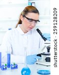woman working with a microscope ... | Shutterstock . vector #259128209