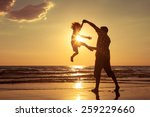 father and son playing on the... | Shutterstock . vector #259229660