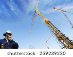 construction worker talking to... | Shutterstock . vector #259239230