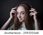 Beautiful Woman With Headphone...