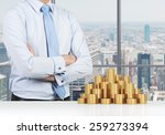 Businessman Standing In Office...