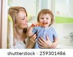 Mother Teaching Son Child Teet...