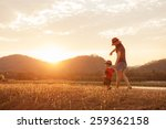 a mother and son playing... | Shutterstock . vector #259362158