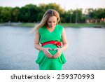 a pregnant woman on the beach | Shutterstock . vector #259370993