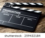 movie clapper on wood background | Shutterstock . vector #259432184