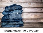Jeans Stacked On A Wooden...