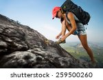 lady hiker with backpack... | Shutterstock . vector #259500260