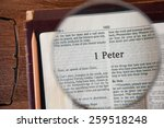 "Small photo of CHIANGMAI, THAILAND, March 3,2015. Reading The New International Version of the Holy Bible on the page of "" 1 peter "" at home. March 3,2015"