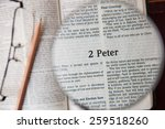 """Small photo of CHIANGMAI, THAILAND, March 3,2015. Reading The New International Version of the Holy Bible on the page of """" 2 peter """" at home. March 3,2015"""