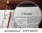 "Small photo of CHIANGMAI, THAILAND, March 3,2015. Reading The New International Version of the Holy Bible on the page of "" 1 timothy "" at home. March 3,2015"
