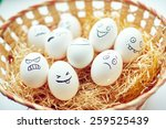 basket with funny eggs with... | Shutterstock . vector #259525439