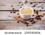 cup of coffee on wooden table ... | Shutterstock . vector #259540406