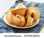 the fortune cookie on plate | Shutterstock . vector #259562840