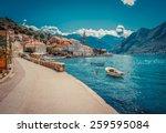 Harbour and boats in sunny day at Boka Kotor bay (Boka Kotorska), Montenegro, Europe. Retro toned image.