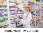 junior pharmacist taking... | Shutterstock . vector #259613888