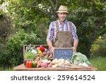 Happy Farmer Showing His...