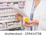 pharmacist looking at... | Shutterstock . vector #259614758