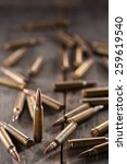 rifle bullets on wood table... | Shutterstock . vector #259619540