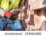 worker using a drilling power... | Shutterstock . vector #259681880