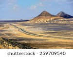 View from above on the road in the Black desert,  Egypt, Sahara - stock photo