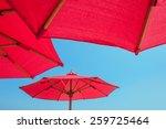 Red Beach Umbrella Against...