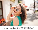 young woman in round sunglasses ... | Shutterstock . vector #259758263
