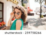 young woman in round sunglasses ... | Shutterstock . vector #259758266