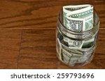 Single Dollar Bills In Glass...