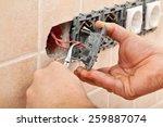 Electrician Hands Installing...
